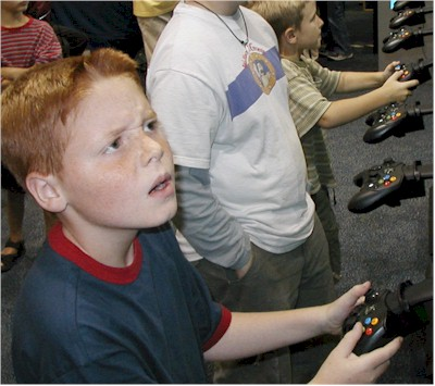 Dunn testing the game 'Bionicle' at the Pacific Science Center.